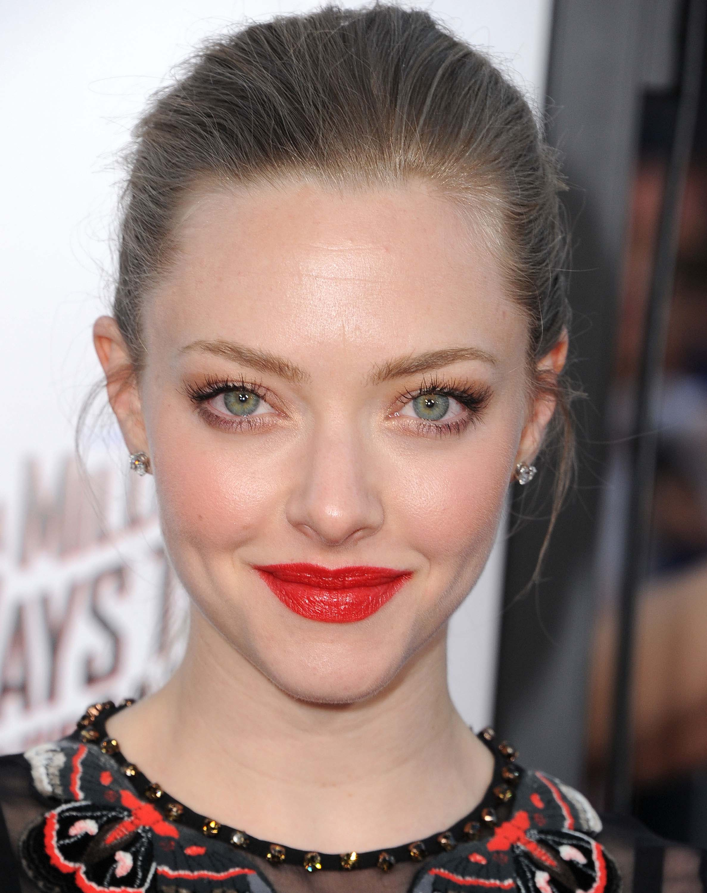 """WESTWOOD, CA - MAY 15:  Amanda Seyfried arrives at the """"A Million Ways To Die In The West"""" - Los Angeles Premiere at Regency Village Theatre on May 15, 2014 in Westwood, California.  (Photo by Steve Granitz/WireImage)"""