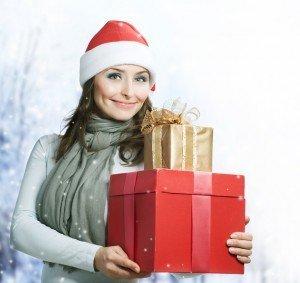 Beautiful Santa Girl with Christmas Holidays Gifts